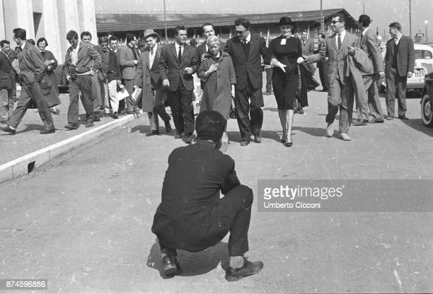 A photographer taking a photo of film director Federico Fellini actor Marcello Mastroianni actress Giulietta Masina and actress Anita Ekberg May 1959