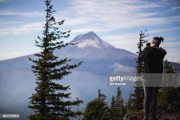 photographer taking a picture of mount hood in oregon - mt hood national forest stock pictures, royalty-free photos & images