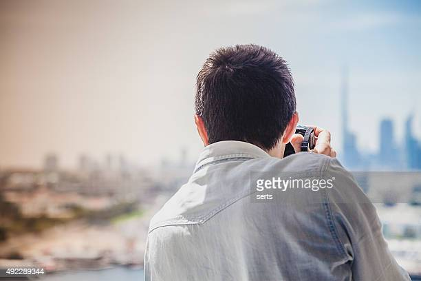 Photographer taking a picture of the Dubai City