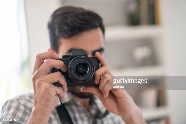 photographer taking a picture with his camera - photojournalist stock pictures, royalty-free photos & images