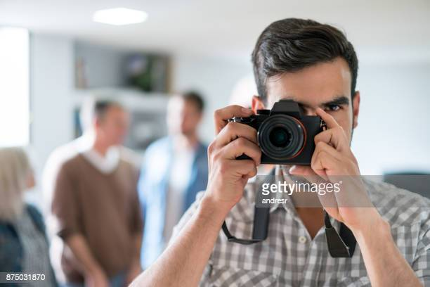 Photographer taking a picture with his camera