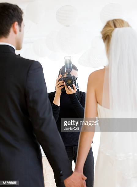 Photographer taking photo of Bride and Groom