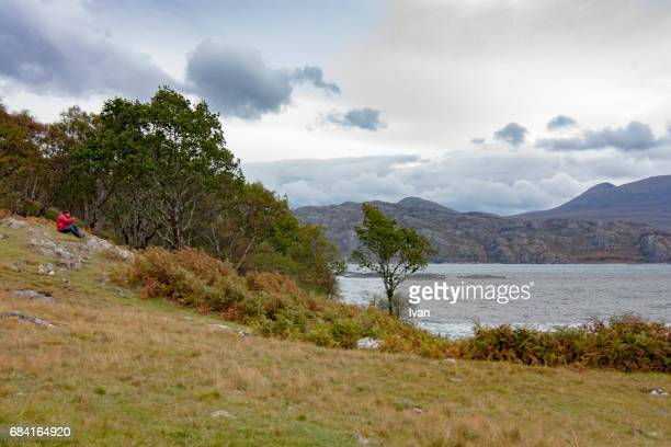 a photographer taking photo of landscape near ness lake, scotland, united kingdom - loch ness stock photos and pictures