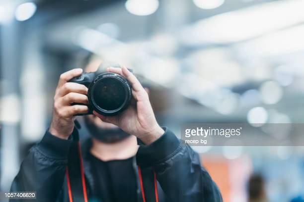 photographer taking photos at night - art and craft product stock pictures, royalty-free photos & images