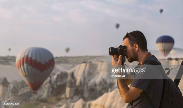 photographer taking photos in cappadocia - photographer stock photos and pictures