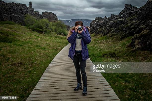 photographer taking photos in þingvellir national park - thingvellir national park stock photos and pictures