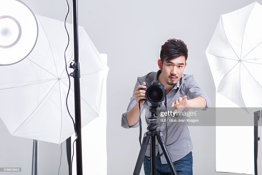 Photographer Taking Picture In Studio Stock Photo