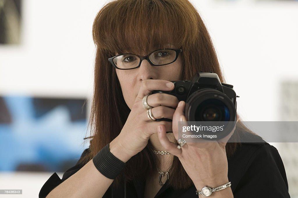 Photographer taking picture : Stockfoto