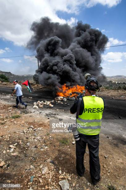 Photographer taking pictures during demonstration. Clashes between Palestinian demonstrators and the Israeli army at Kafr Qaddum . In this village,...