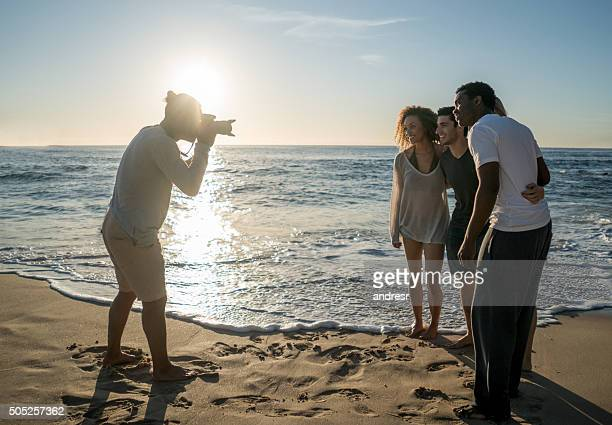 Photographer taking pictures of people at the beach