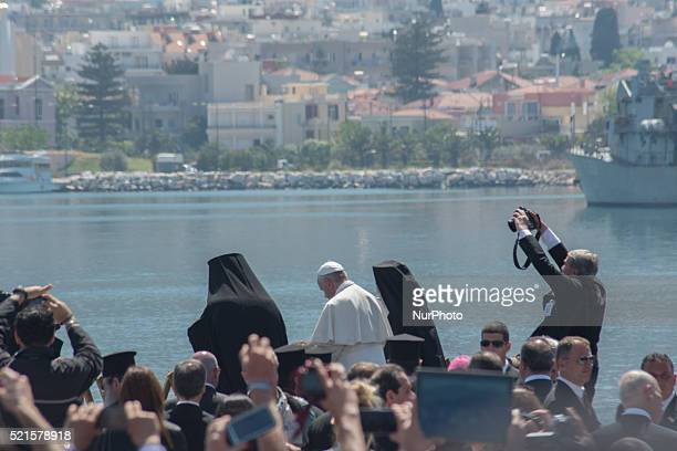 A photographer taking pictures of the Pope francis in the Island of Lesvos on April 16 2016