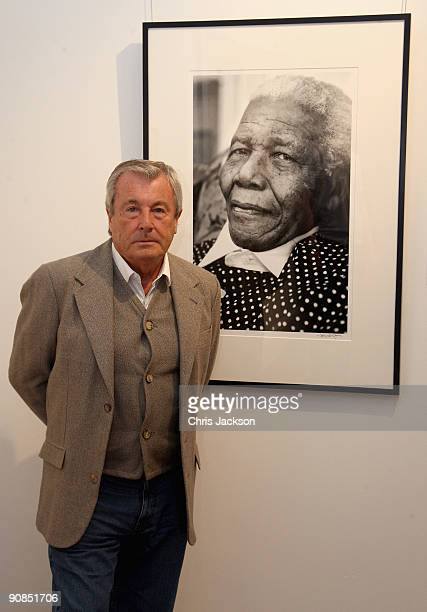 Photographer Terry O'Neil poses for a portrait next to his work at Sothebys on September 16, 2009 in London, England. O'Neil is one of the artists...