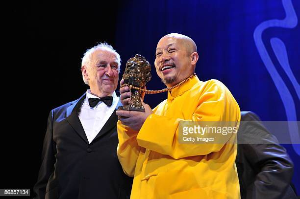 Photographer Thomas Hoepker and Yan Yankang category best photography attends the HenriNannenAward at the Schauspielhaus on May 8 2009 in Hamburg...