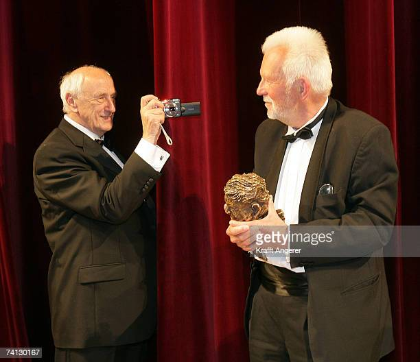 Photographer Thomas Hoepker takes a picture of photographer Robert Lebeck at the Henri Nannen Award at the Schauspielhaus on May 11 2007 in Hamburg...