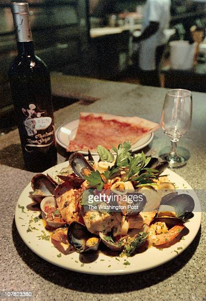 TOM ALLEN TWP LOCATION Mamma Lucia Olney MD91008 Photo of a pasta dish of Salmon Adriatico consisting of fresh salmon musselsclams shrimp tender...