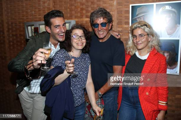 Photographer Tony Frank poses with his children Billy Charlotte and SarahLee during the Hugues Aufray by Tony Frank Exhibition for the singer's 90th...