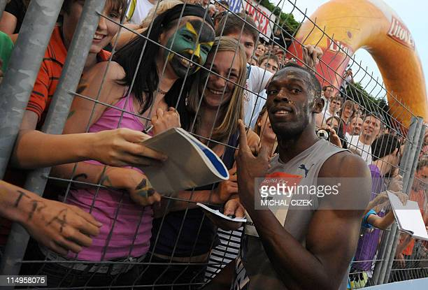CORRECTION Photographer Usain Bolt of Jamaica poses with his fans after competing in the men's 100m sprint on May 31 2011 at the Zlata Tretra...