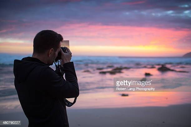 Photographer using filter with camera