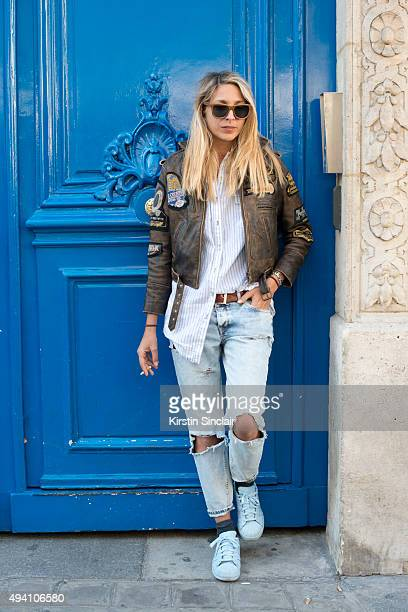 Photographer Valentina Frugiuele wears a vintage jacket Mango trousers Adidas trainers Zara shirt and Parkville sunglasses on day 3 during Paris...