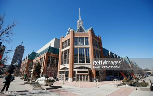 A photographer walks outside the Wisconsin Center one of the sites for the 2020 Democratic National Convention in Milwaukee Wisconsin on March 11...