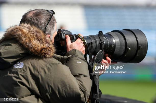 Photographer watches the action through a 400mm lens during the Sky Bet Championship match between Huddersfield Town and Brentford at John Smith's...