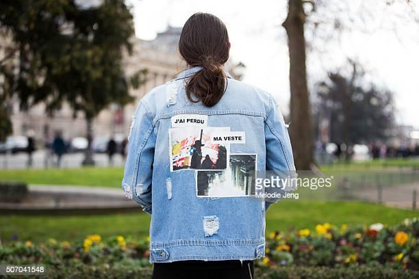 A photographer wears a Nabilue Quenum 'J'ai Perdu Ma Veste' JPMV x Pimkie denim patchwork jacket at the Chanel couture show at Grand Palais on...