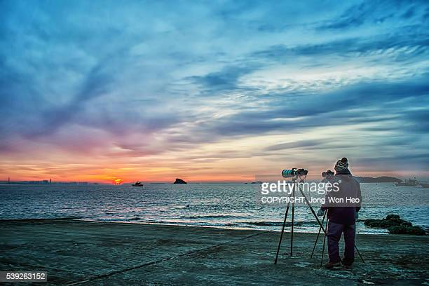 A photographer who was waiting for the sunrise