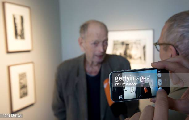 Photographer Will McBride stands in front of one of his photos among pictures from the Magnum agency of which he is a member in the new location of...