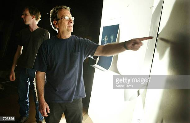 Photographer William Wegman views proofs from a promotional photo shoot of his Weimaraner dogs for the Tony Awards April 16 2002 in New York City