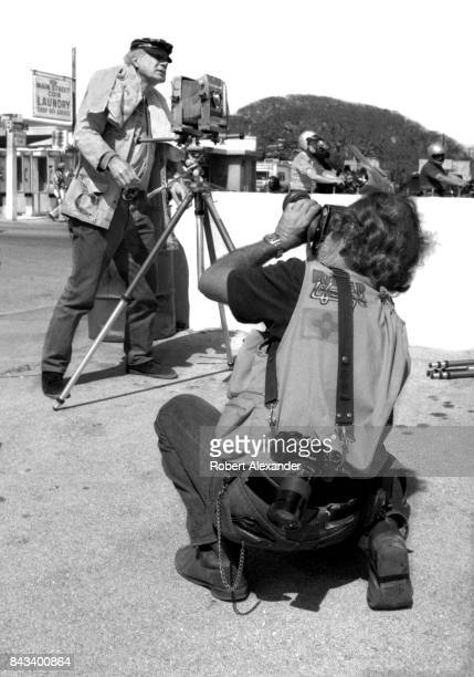 A photographer with Biker Lifestyle magazine takes a picture of legendary photojournalist Eddie Adams in Daytona Beach Florida during the city's 1983...