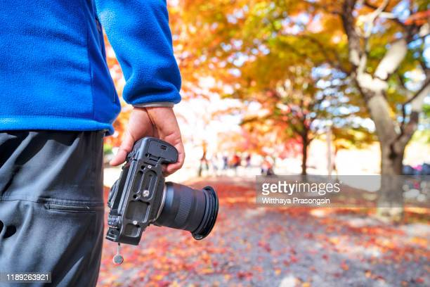 photographer with leather bag - ルポルタージュ ストックフォトと画像