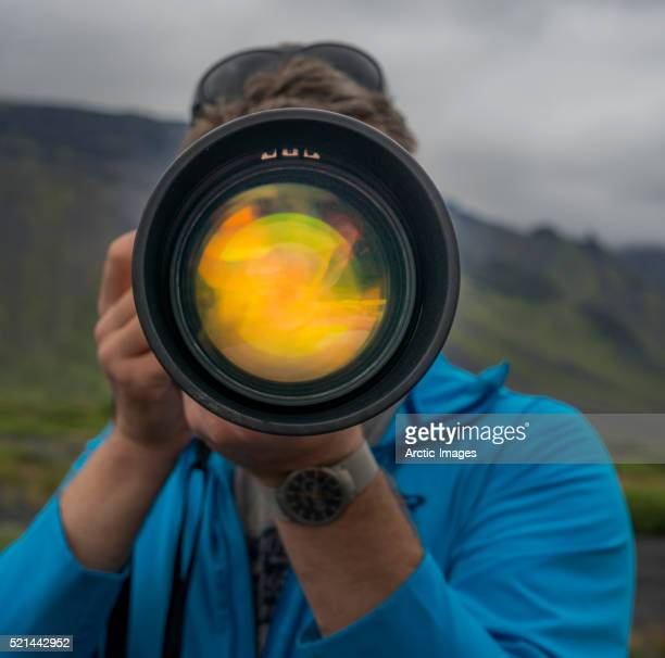 Photographer with long lens.