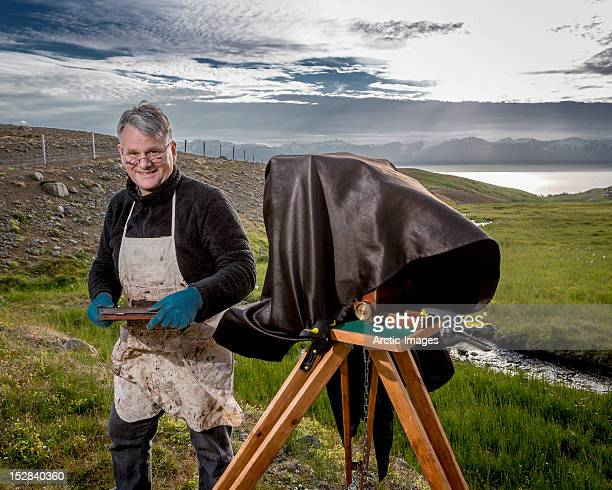 Photographer with old large format camera