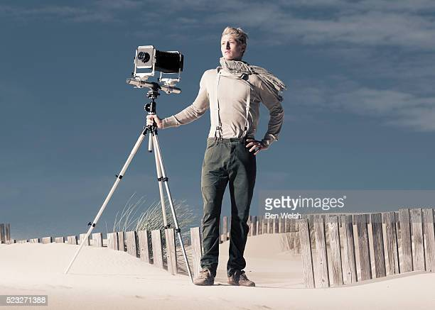 Photographer with old large format camera.