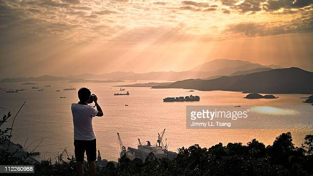 Photographer with sunset