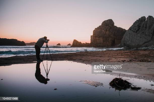 photographer with tripod at sunset - cinematographer stock pictures, royalty-free photos & images