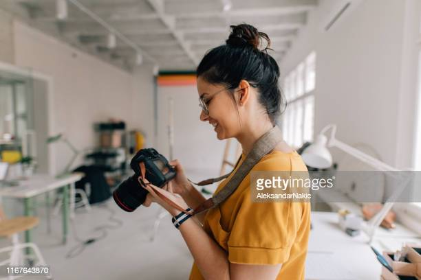 photographer working in a studio - photography themes stock pictures, royalty-free photos & images