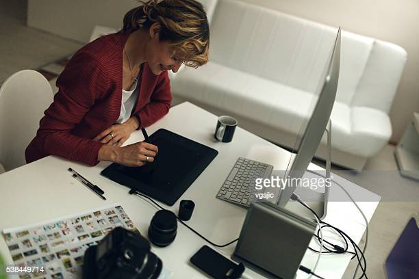 Photographer Working In Her Office