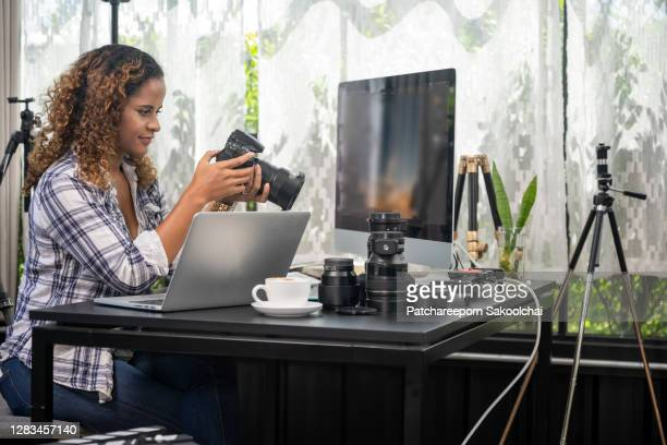 photographer working in her room - photographer stock pictures, royalty-free photos & images