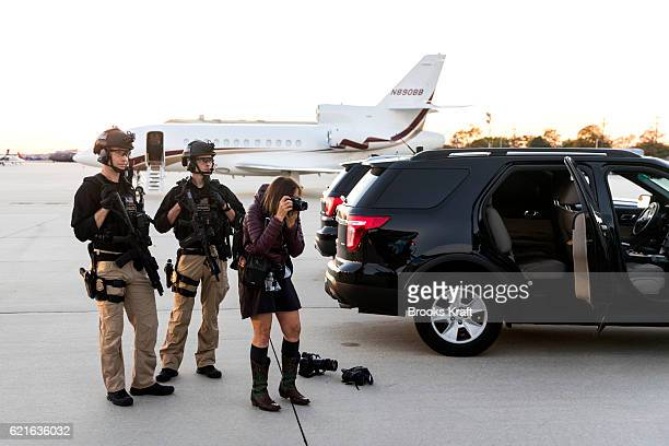 A photographer works in front of the Secret Service as Presidential candidate Hillary Clinton arrives in Philadelphia November 5 2016 in Philadelphia...