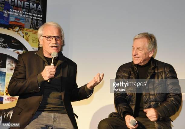 Photographer Yann Arthus Bertrand and director Costa Gavras attend 'Semaine du Cinema Positif' Cocktail at Terrasse du Publicis Cinema on April 25...