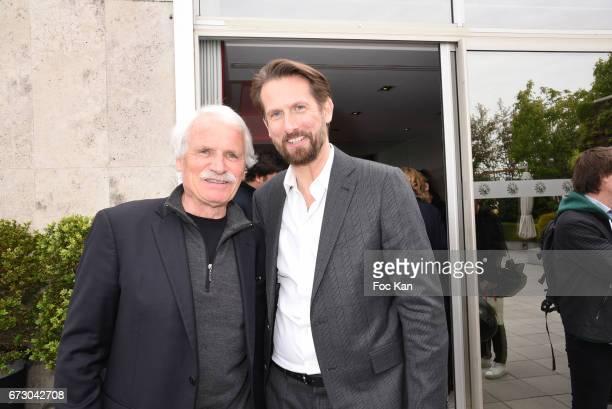 Photographer Yann Arthus Bertrand and PR /cofounder of La Baule Cinema and music Festival Sam Bobino attend 'Semaine du Cinema Positif' Cocktail at...