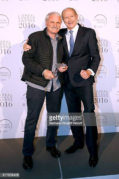 Photographer Yann ArthusBertrand and Chairman Chief Executive Officer of L'Oreal and Chairman of the L'Oreal Foundation JeanPaul Agon attend the...