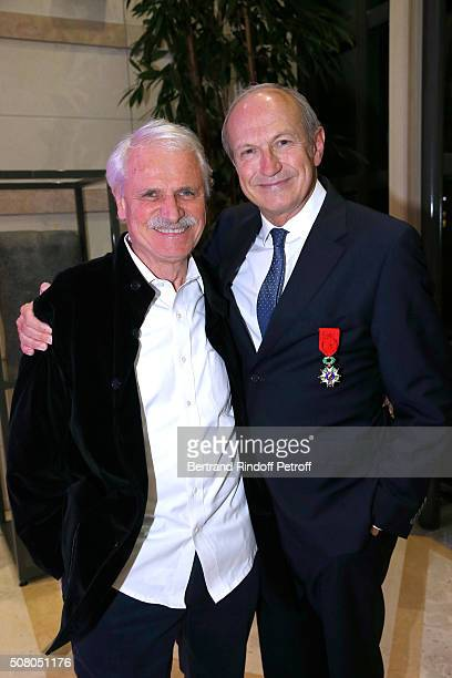 Photographer Yann ArthusBertrand and JeanPaul Agon attend President of l'Oreal JeanPaul Agon receives Insignia of Officer of the Legion of Honor at...