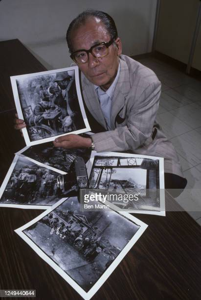 Photographer Yoshito Matsushiga with 5 photographs he took of Hiroshima in immediate aftermath of Abomb drop Japan June 1981