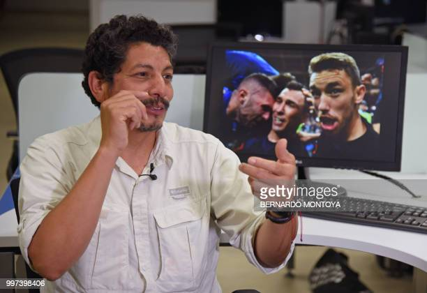 AFP photographer Yuri Cortez who unwittingly became part of the celebrations of Croatia in their World Cup semifinal match against England gestures...