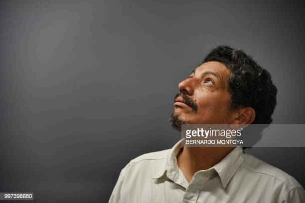 AFP photographer Yuri Cortez who unwittingly became part of the celebrations of Croatia in their World Cup semifinal match against England poses...