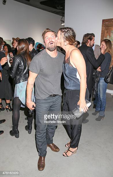 Photographer/artist Brian Bowen Smith and Shea Bowen Smith attend the 'Blue Nudes' exhibition at De Re Gallery on May 28 2015 in West Hollywood...