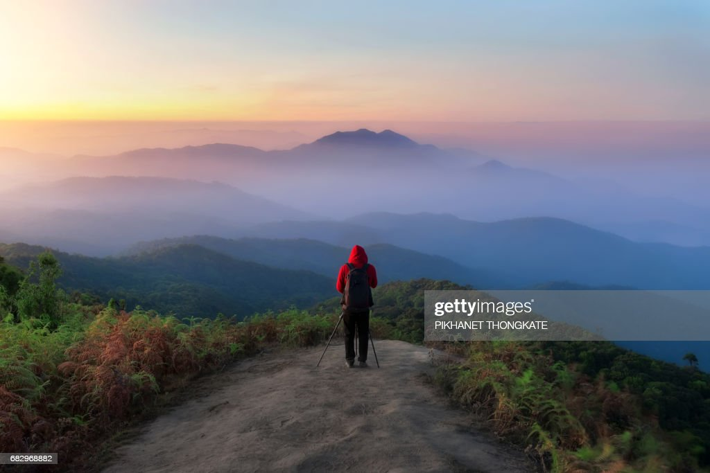Photographerat on doi inthanon national park with beautiful sunrise Chiang Mai Province, Thailand
