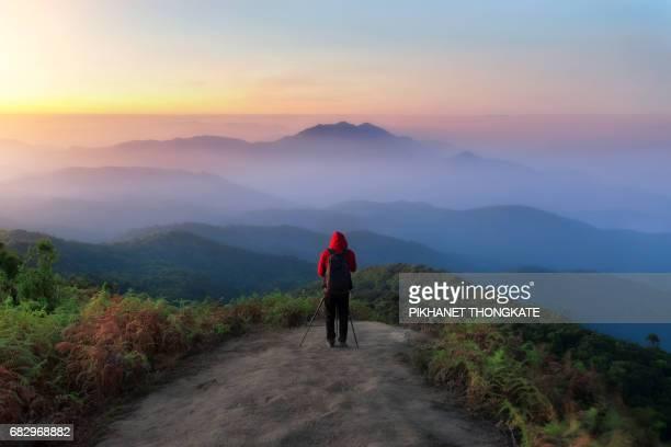 Photographerat on doi inthanon national park with beautiful sunrise Chiang Mai Province, Thailand